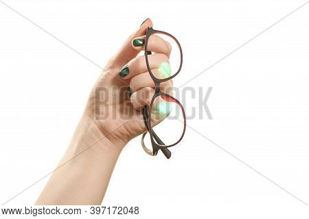 Girl With A Beautiful Mother-of-pearl Manicure Holds The Glasses On A White Background