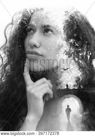 A balck and white concept paintography portrait of a thoughtful young woman with curly hair