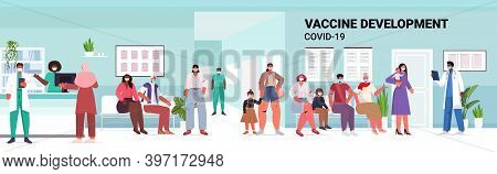 Mix Race Patients Sitting In Hospital Corridor People Waiting For Covid-19 Vaccine Coronavirus Preve