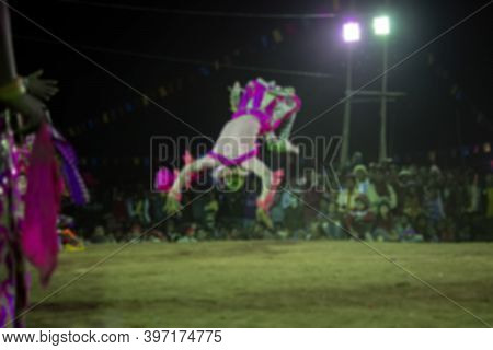 Blurred Image Of Tribal Dancer Jumping In Air, Erforming At Chhou Dance Festival. Indian Tribal Mart