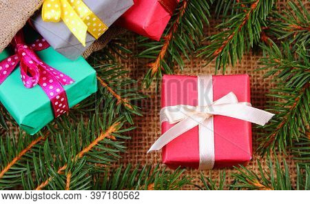 Wrapped Colorful Gift For Christmas, Birthday Or Other Celebration And Framework Of Spruce Branches