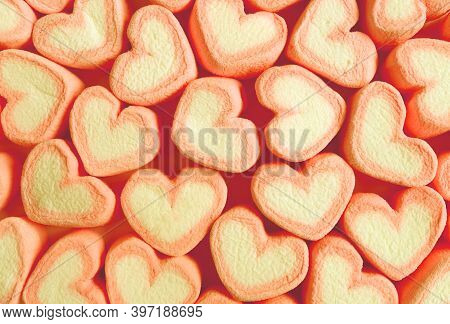Rows Of Pastel Orange And Yellow Heart Shaped Marshmallow Candies For Abstract Background