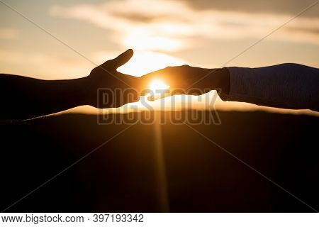 Outstretched Hands, Salvation, Help Silhouette, Concept Help. Giving A Helping Hand. Rescue, Helping