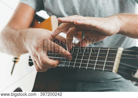 Close-up On The Hands Of A Guitarist Playing Classical Guitar In Two Handed Tapping Technique.