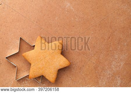 Homemade Gingerbread Cookie Star And Cookie Cutter On Raw Gingerbread Dough. Empty Room For Text. To