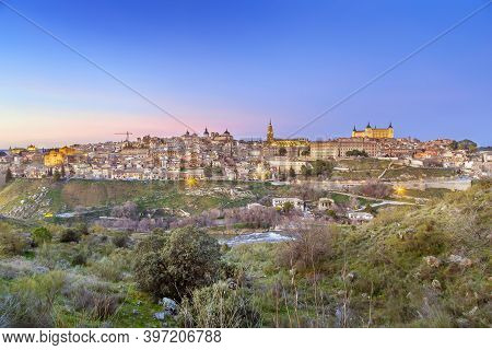 View Of Toledo From Across The Tagus River In Evening, Spain