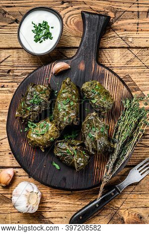 Traditional Georgian Dolma In Grape Leaves. Wooden Background. Top View