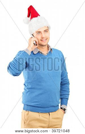 A casual guy wearing a santa hat and talking on a mobile phone isolated on white background