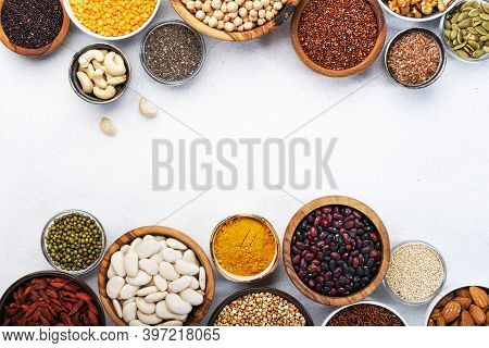 Various Superfoods, Legumes, Cereals, Nuts, Seeds In Bowls On White Background. Superfood As Chia, S