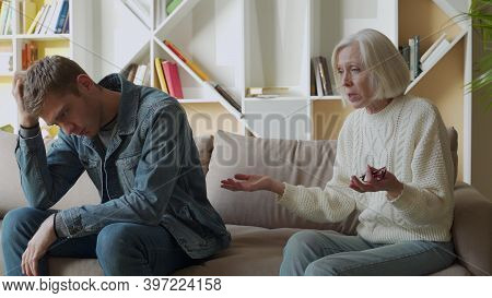 Angry Aged Mother Quarreling, Arguing With Son, Bad Family Relationships Concept, Parent And Child C