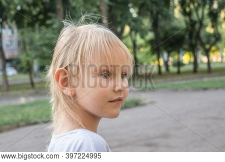 Profile Of A Little Cute Girl With White Hair, 5 Years Old, Who Looks Into The Distance With Surpris