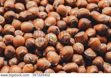Hazelnuts. Food Background, Wallpaper. Stack Of Hazelnuts.