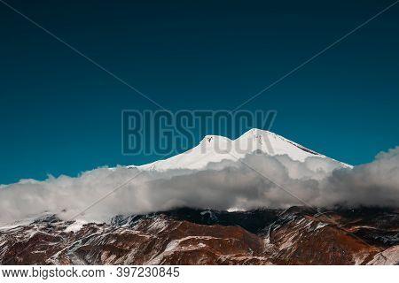 Elbrus Mount With Clouds Against The Blue Sky. North Caucasus, Russia. Beautiful Autumn Landscape