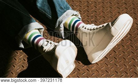 High top white sneakers on model casual style