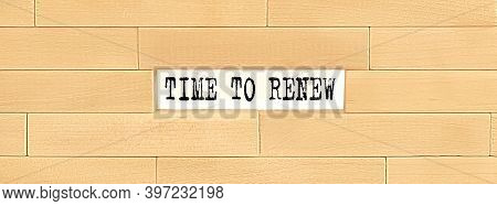 Time To Renew . Text On The Wooden Block Wall, Business Concept