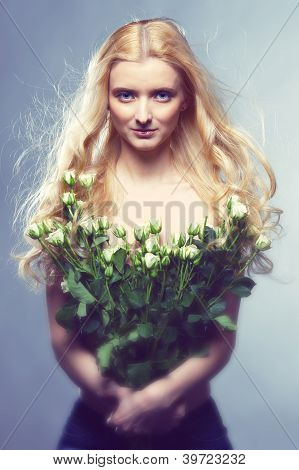 The girl with flowers.