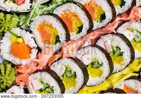 Sushi Background. Tasty Food On Buffet Party. Banquet Snacks Texture. Raw Fish Snacks. Japanese Typi
