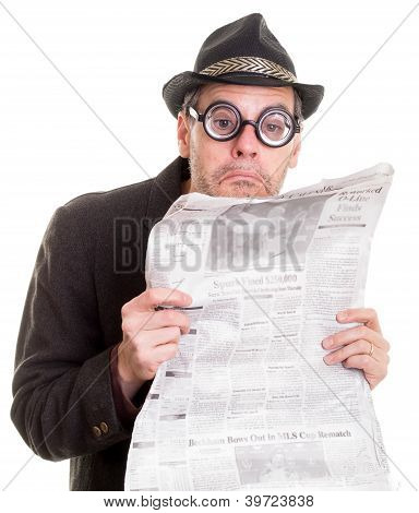 Funny Man Reading a Newspaper