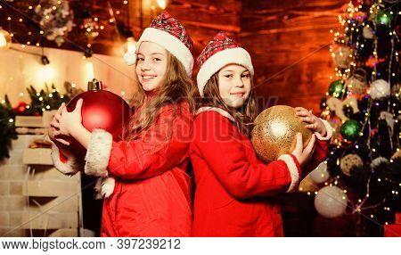 Festive Decor. Santa Claus Little Girls Sisters. Little Girl Sisters In Red Hats. Wait For Santa Cla