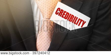 Businessman Holding A Card With Text Credibility. Financial Business Concept