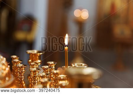 Orthodox Church. Christianity. Festive Interior Decoration With Burning Candles And Icon In Traditio