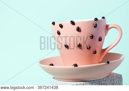 Black Ladybugs With Small Red Spots On Pink Tea Cup.