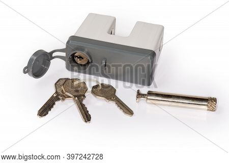 Unlocked Padlock With Rod, Which Taken Out To Unlock, Plastic Cover Of A Keyhole And Keys Lying Apar