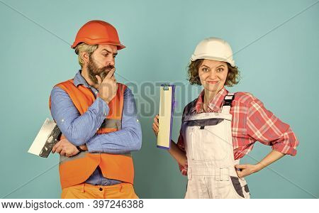 Woman And Man Safety Hard Hat. Discussing Renovation With Contractor. Sign Contract With Workers. Pr