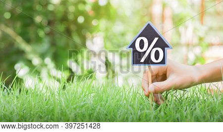 People Are Putting House Signs With Interest Symbols With Place Pins And Green Grass. The Concept Of