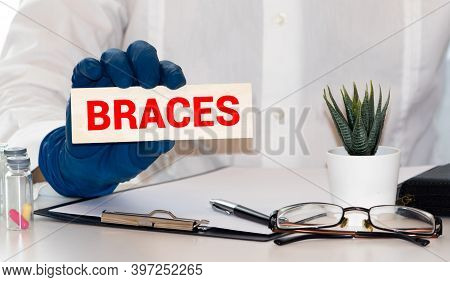 Hand Writing Braces With The Abstract Background. The Word Braces Represent The Meaning Of Word As C