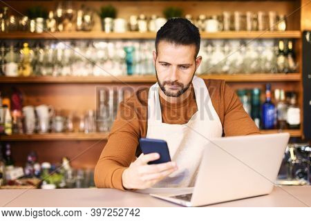 Small Cafe Owner Businessman Standing Behind The Counter And Working
