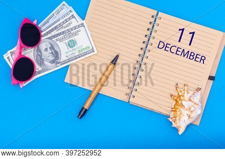 December 11. 11th Day Of December. Travel Plan Flat Design With Written Date Notepad, Pen, Glasses,