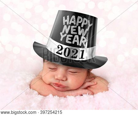 Newborn baby girl wearing a 2021 Happy New Year hat.