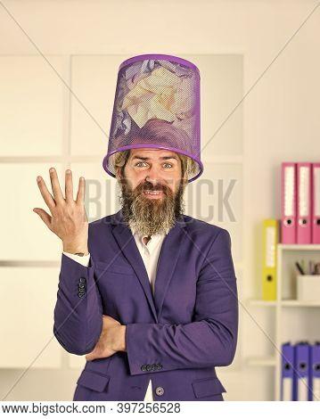Looking So Funny. Man In Office Look For Lost Note In Paper Bin. Crumpled Paper In Wastepaper Basket