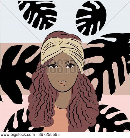 Young Black Woman In A Scarf On Her Head. Background From Monstera Leaves. Portrait Of An African Am