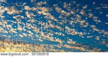 Colorful Altocumulus Clouds At Dusk. Beautiful Natural Scenery Background.