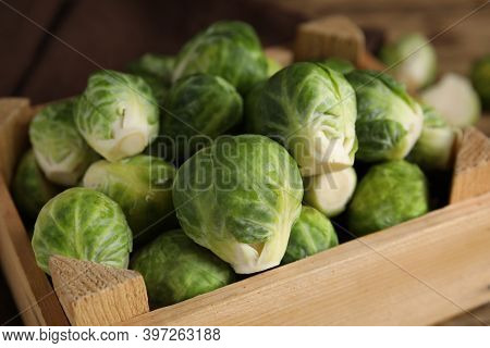 Fresh Brussels Sprouts In Wooden Crate, Closeup