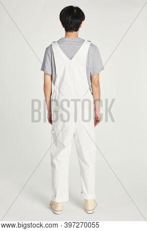Rear view man wearing white dungarees mockup