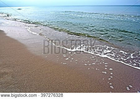Sandy Deserted Seashore. Cold Deserted Beach. Baltic Sea