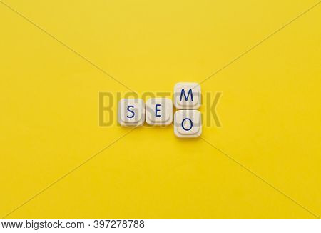 Sem Or Seo Words Made With Letters Of A Board Game, Over A Yellow Background. Search Engine Concepts
