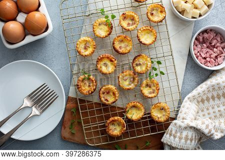 Mini Ham And Cheese Quiches Freshly Baked On A Cooling Rack