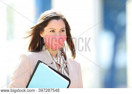 Businesswoman Wearing Mask Avoiding Coronavirus Contagion Walking In The Street