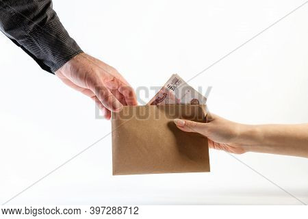 Illegal Salary. A Mans Hand In A Black Shirt Takes An Envelope With Money From A Womans Hand. Side V
