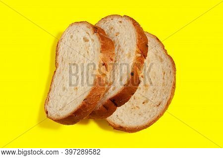 Fragrant Delicious Bread With Fried Onions And Crispy Crust On A Yellow Background