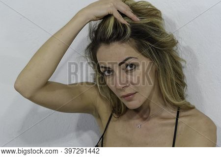 Close Up Of Blonde Girl. White Background. Copy Space.