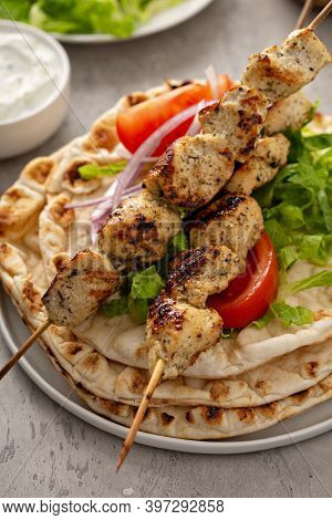 Chicken Souvlaki With Fresh Vegetables On A Flatbread With Tzatziki Sauce