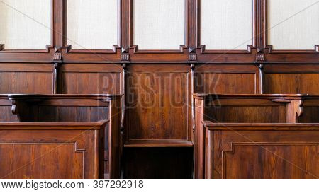Detail Of Traditional Hard Wood Courthouse, Church Choir Sitting Area. Interior With Empty Wooden Se