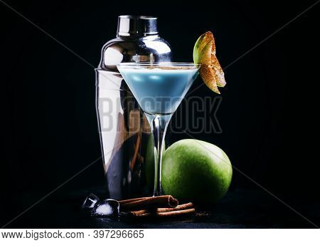 Alcoholic Cocktail Blue Temptation, With Vodka, Liqueur, Cream, Decorated With Green Apple, And Grou