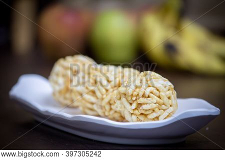 View Of Sweet Puffed Rice Balls(also Known As Muri, Porri) In A Bowl. Muri Ball Is Famous Sweet Of I
