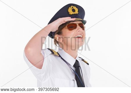 Beautiful woman pilot wearing uniform with epauletes, standing isolated on white background.